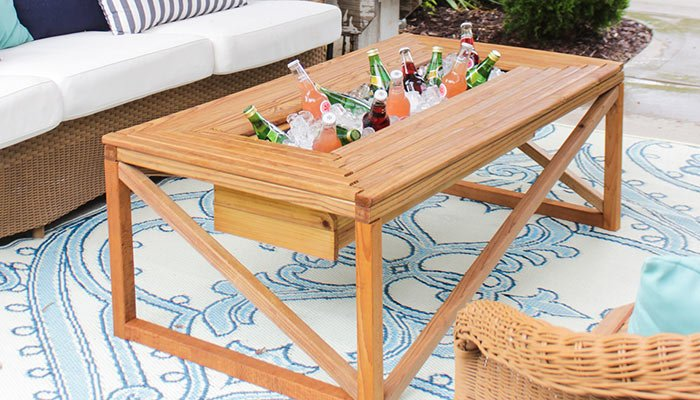 outdoor coffee table with a beverage cooler