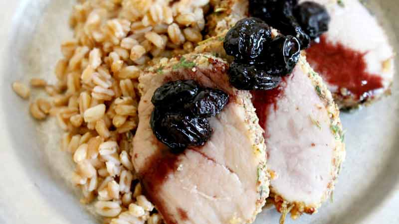 Almond crusted pork loin with red wine raisins