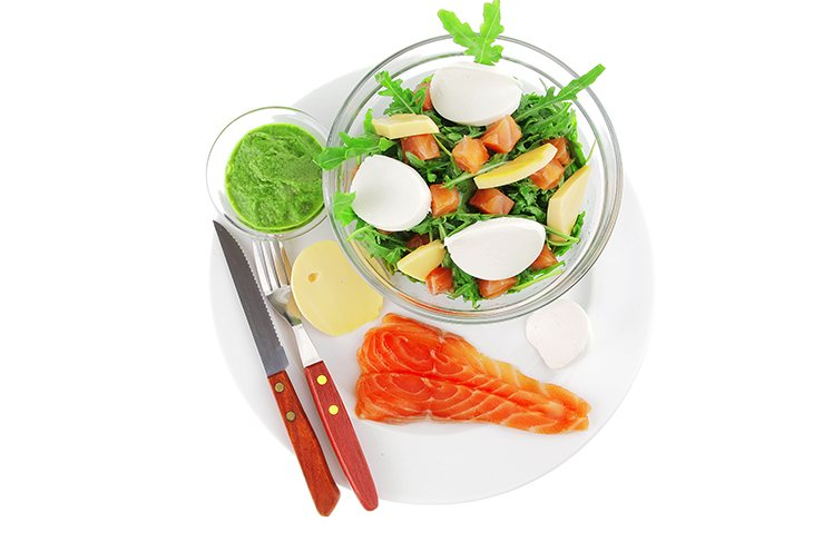 Green Salad With Smoked Salmon In Transparent Bowl On Plate